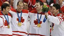 Canadian players, from left, Patrice Bergeron, Ryan Getzlaf, Rick Nash and Sidney Crosby celebrate with their gold medals after their win over the U.S. in the men's ice hockey gold medal game at the Vancouver 2010 Winter Olympics February 28, 2010. (Reuters)