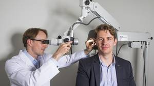 Michael Chrostowski, co-founder of Hamilton-based Sound Options, which has developed a software-based tinnitus therapy, is examined by otolaryngologist Alexander J. Osborn with an ear microscope at the The Voice Clinic in Toronto.