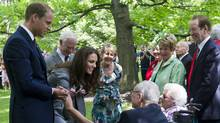 The Duke and Duchess of Cambridge greet C.B. and Edna Marsh (seated) after a tree planting ceremony at Rideau Hall in Ottawa. (NATHAN DENETTE/THE CANADIAN PRESS)