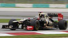 Lotus driver Kimi Räikkönen steers his car during the third practice session at the Malaysian Formula One Grand Prix in Sepang on Saturday, March 24, 2012. (Achmad Ibrahim/AP)
