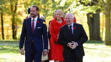 Crown Prince Haakon and Crown Princess Mette-Marit walk with Governor-General David Johnston in Ottawa on Monday. (Sean Kilpatrick/THE CANADIAN PRESS)