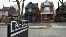 """A """"for sale"""" sign stands in front of detached homes on Redwood Avenue in Toronto on Tuesday, April 7, 2015. Darren Calabrese for The Globe and Mail (Darren Calabrese For The Globe and Mail)"""