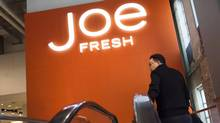 A shopper rides an escalator to the Joe Fresh outlet located in the former Maple Leaf Gardens in Toronto on Thursday, May 1, 2014. (Darren Calabrese/THE CANADIAN PRESS)