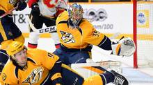Nashville Predators goalie Pekka Rinne slides over to cover the net as Filip Forsberg goes to block a shot during the second period against the Calgary Flames at Bridgestone Arena in Nashville, on March 23, 2017. (Christopher Hanewinckel/USA Today Sports)