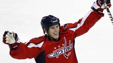 Washington Capitals centre Brooks Laich celebrates after teammate Jason Arnott scored during the first period of an NHL hockey game against the Chicago Blackhawks at the Verizon Center in Washington on Sunday, March 13, 2011.Laich is staying with the Washington Capitals.The forward signed a six-year extension just days before becoming an unrestricted free agent. (Jacquelyn Martin)