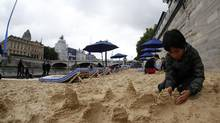 """Paris Plages"" (Paris Beaches) opens along banks of the Seine river. (ERIC GAILLARD/Reuters)"