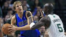 Dallas Mavericks forward Dirk Nowitzki looks to pass defended by Boston Celtics forward Kevin Garnett in the second quarter of their NBA Basketball game in Boston, Massachusetts January 11, 2012. (REUTERS/Adam Hunger)