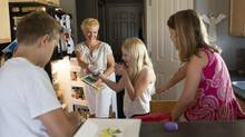 Ceone Fournier, centre, and her kids Owen, 11, left to right, Claire, 9, and Maisy, 6, make a snack in their home in Spruce Grove, Alberta on Thursday, July 24, 2014. Fournier was involved in the Health Canada consultations on the proposed labeling modernization. (AMBER BRACKEN For The Globe and Mail)