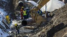 """The """"Line 9"""" Enbridge oil pipeline is seen being worked on in East Don Parkland in Toronto, March 6, 2014. The Chippewas of the Thames want the Supreme Court to overturn a permit given to Enbridge Inc. to reverse and expand the flow of the Line 9 pipeline between Sarnia, Ont., and Montreal. (MARK BLINCH/REUTERS)"""