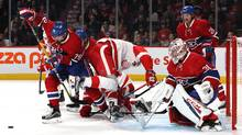 Montreal Canadiens defenceman Andrei Markov (79) helps goalie Carey Price (31) to make a save against Detroit Red Wings during the second period at Bell Centre in Montreal on Nov. 12, 2016. (Jean-Yves Ahern/USA Today Sports)
