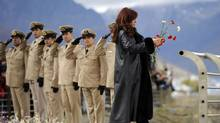 Argentine President Cristina Fernandez de Kirchner prepares to throw flowers into the Bahia de Ushuaia (Ushuaia Bay) waters to pay homage to the fallen soldiers during the Falklands War in Ushuaia April 2, 2012. (STRINGER/ARGENTINA/REUTERS)