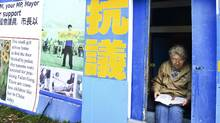 A women sits in the Falun Gong protest shed at the Chinese Consulate on August 11, 2008. (Jennifer Roberts/ The Globe and Mail/Jennifer Roberts/ The Globe and Mail)