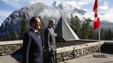 French President François Hollande, left, and Prime Minister Stephen Harper meet in Banff, Alta., on Sunday. (Jeff McIntosh/THE CANADIAN PRESS)