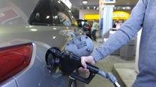 A customer fills up at a gas station in Toronto. (Fred Lum/The Globe and Mail)