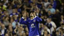 Everton's Marouane Fellaini celebrates after scoring against Manchester United during their English Premier League soccer match at Goodison Park Stadium, Liverpool, England, Monday, Aug. 20, 2012. (Jon Super/The Associated Press)