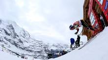 Canada's Erik Guay wasn't expected to do well in the World Cup downhill event on Dec. 21, 2013, at Val Gardena, in Italy, but the last third of the race was a thing of beauty and he knew it. (Giovanni Auletta/AP)