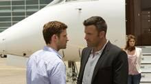Justin Timberlake, left, and Ben Affleck in a scene from Runner Runner. (Scott Garfield/AP)