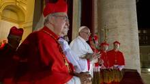 Newly elected Pope Francis, Cardinal Jorge Mario Bergoglio of Argentina, appears on the balcony of St. Peter's Basilica with fellow cardinals after being elected by the conclave of cardinals, at the Vatican, March 13, 2013. (Osservatore Romano/REUTERS)