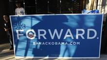 A supporter of U.S. president Barack Obama casts a shadow on a campaign sign as she waits to march with others to deliver ballots to a polling place in Denver, Colorado October 30, 2012. (RICK WILKING/REUTERS)