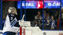 Winnipeg Jets' goalie Ondrej Pavelec reacts after giving up his fifth goal of the game to the Tampa Bay Lightning during the second period of their NHL game in Tampa, Florida February 1, 2013. (MIKE CARLSON/REUTERS)