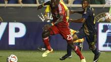 Toronto FC's Dominic Oduro, left, drives to the goal with Philadelphia Union's Raymon Gaddis, right, giving chase during the second half of an MLS soccer match, Wednesday, Sept. 3, 2014, in Chester, Pa. The Union won 1-0. (Chris Szagola/AP)