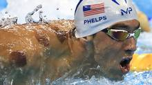 American Michael Phelps is seen with red cupping marks on his shoulder as he competes in the 200m butterfly at Rio Olympics. (Dominic Ebenbichler/Reuters)