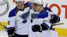 St. Louis Blues' T.J. Oshie (74), Kevin Shattenkirk (22) and Alexander Steen (20) celebrate after Shattenkirk scored during third period NHL action in Winnipeg, Tuesday, December 10, 2013. (Trevor Hagan/THE CANADIAN PRESS)