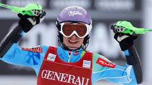 Slovenia's Tina Maze celebrates after winning an alpine ski, women's world cup super-combined, in Meribel, France, Sunday, Feb. 24, 2013. (Marco Trovati/AP)