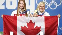 Heather Moyse and Kaillie Humphries during a press conference in Sochi who have been selected as Canadaâs flag bearers for the Closing Ceremony of the Sochi 2014 Olympic Winter Games. (John Lehmann/The Globe and Mail)
