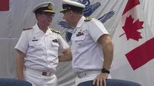 Royal Canadian Navy Vice-Admiral Mark Norman (left) speaks with Vice-Admiral Ron Lloyd during a change of command ceremony, Thursday, June 23, 2016 in Ottawa. Norman, one of the military's highest ranking officers, has been temporarily removed from his post. (Adrian Wyld/The Canadian Press)