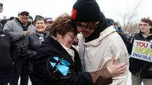 Attawapiskat Chief Theresa Spence greets 18-year-old David Kawapit, the Whapmagoostui man who started the Nishyuu journey. (DAVE CHAN FOR THE GLOBE AND MAIL)