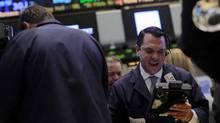 Traders work on the floor of the New York Stock Exchange, November 11, 2013 (BRENDAN MCDERMID/REUTERS)