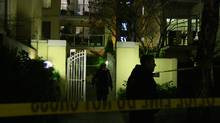 Police are seen outside a west end Vancouver apartment building after a mass stabbing. (Daniel Bitonti/The Globe and Mail)
