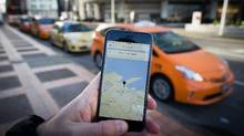 The Uber app is displayed on an iPhone as taxi drivers wait for passengers in downtown Vancouver, B.C., on Monday, Jan. 25, 2016. (DARRYL DYCK FOR THE GLOBE AND MAIL)