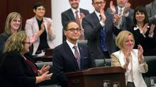 Alberta Finance Minister Joe Ceci, centre, receives a round of appause from his NDP colleagues after delivering the 2015 provincial budget at the Legislative Assembly in Edmonton on Tuesday, Oct. 27, 2015. (TOPHER SEGUIN/THE CANADIAN PRESS)
