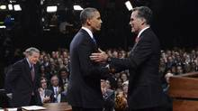 Republican presidential nominee Mitt Romney, right, shakes hands with President Barack Obama at the end of the first 2012 U.S. presidential debate in Denver, Oct. 3, 2012. (Michael Reynolds/Pool/REUTERS)
