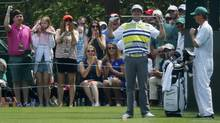 U.S. golfer Bubba Watson bites his club after a good tee shot on the 16th hole during the second round of the Masters golf tournament at the Augusta National Golf Club in Augusta, Georgia April 11, 2014. (MIKE BLAKE/REUTERS)
