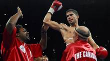 Canadian Steve Molitor celebrates his victory over South African Takalani Ndlovu during their IBF World Junior Featherweight title match in Orillia, Ontario, Saturday, July 14, 2007. (The Canadian Press)