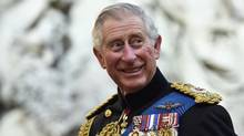 Britain's Prince Charles reacts as he speaks with armed forces personnel during a reception at Guildhall, after the Afghanistan service of commemoration at St Paul's Cathedral in London March 13, 2015. (TOBY MELVILLE/REUTERS)