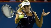 Canada's Aleksandra Wozniak returns to Daniela Hantuchova from Slovakia during first round of play at the Rogers Cup tennis tournament Tuesday, August 7, 2012 in Montreal. Wozniak won 7-5, 7-6 (5). (Paul Chiasson/THE CANADIAN PRESS)