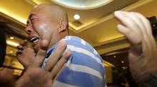 Relatives of passengers aboard Malaysia Airlines MH370 cry after watching a television broadcast of a news conference, in the Lido hotel in Beijing, March 24, 2014. Malaysian Prime Minister Najib Razak has told families of passengers of a missing Malaysian airliner that the plane ended its journey in the southern Indian Ocean, he said on Monday. (REUTERS/Jason Lee)