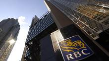 Exterior of theRoyal Bank Plaza towers at the corner of Bay St. and Wellington St. West in Toronto on April 17 2014. Investors will get a first look at earnings results when Royal Bank of Canada reports earnings on Friday. (Fred Lum/The Globe and Mail)
