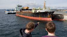 People check the MV Ocean Lady in Victoria, on Oct.18, 2009. Four men accused of smuggling dozens of Tamil migrants into Canada were simply part of the effort to get themselves and the rest of the asylum seekers across the Pacific Ocean, their lawyers told a court on Wednesday. (ARNOLD LIM/THE CANADIAN PRESS)