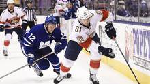 Toronto Maple Leafs right wing Connor Brown (12) chases Florida Panthers centre Jonathan Marchessault (81) during first period NHL hockey action in Toronto on Thursday, November 17, 2016. (Nathan Denette/THE CANADIAN PRESS)