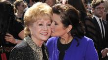 In this Sept. 10, 2011, file photo, Debbie Reynolds, left, and Carrie Fisher arrive at the Primetime Creative Arts Emmy Awards in Los Angeles. (Chris Pizzello/AP)