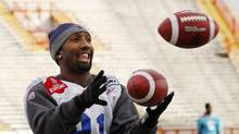 Montreal Alouettes' Kerry Watkins juggles footballs during the team's CFL Grey Cup football practice in Calgary, Alberta November 25, 2009. Calgary will host the Canadian Football League's 97th Grey Cup between the Saskatchewan Roughriders and the Montreal Alouettes on Sunday. REUTERS/Todd Korol (TODD KOROL)