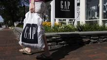 A shopper leaves a Gap store in Freeport, Maine. (Pat Wellenbach/Pat Wellenbach/AP)