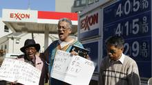 Americans protest rising prices at a gas station in Washington on Feb. 23, 2012. (GARY CAMERON/REUTERS)
