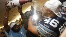 Argos celebrate in their locker room after their win at the 100th Grey Cup game played in Toronto on Nov. 25, 2012 between the Toronto Argonauts and the Calgary Stampeders. (Peter Power/The Globe and Mail)