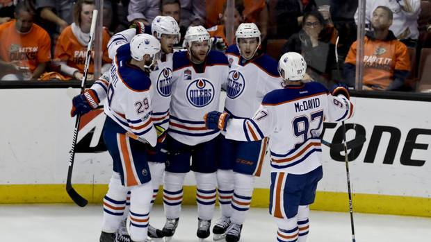 The Edmonton Oilers celebrate after a Mark Letestu goal against the Anaheim Ducks during Game 1 of their playoff series Wednesday in Anaheim, Calif.